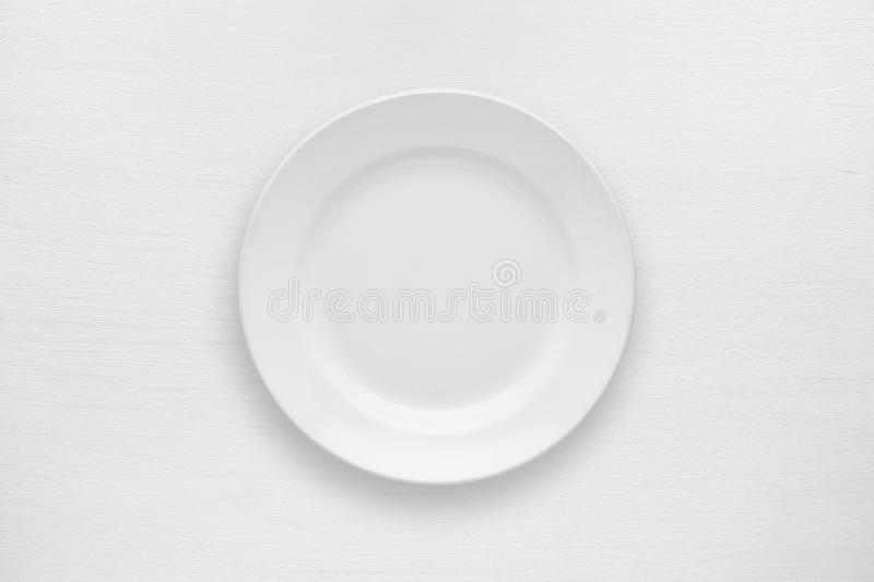 Empty plate on white table royalty free stock photography