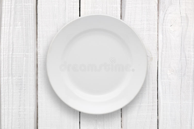 Empty plate on white table stock image