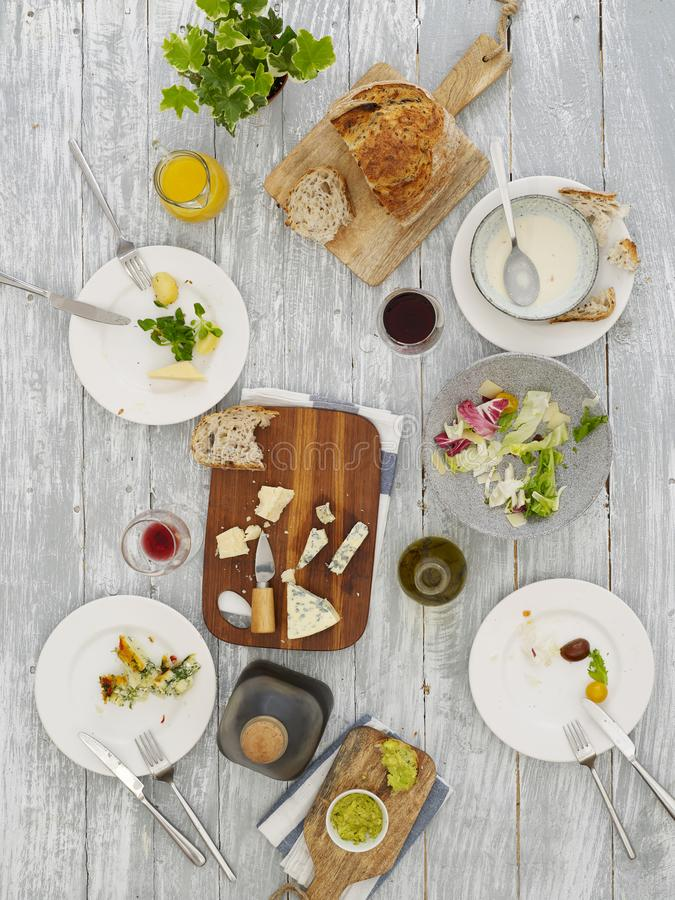 Empty plates on dinner table stock image