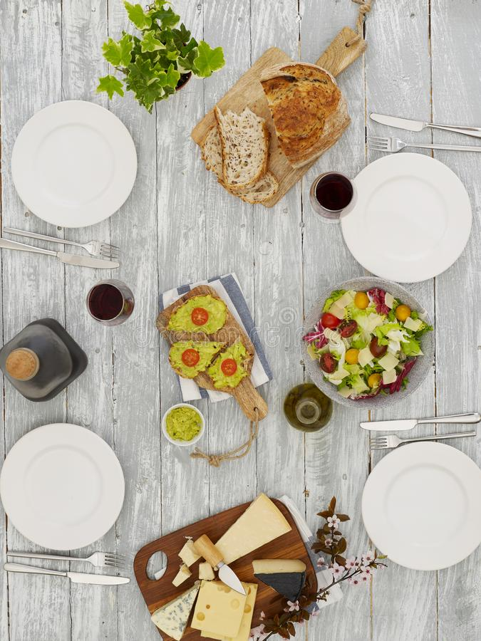 Empty plates on dinner table royalty free stock photo