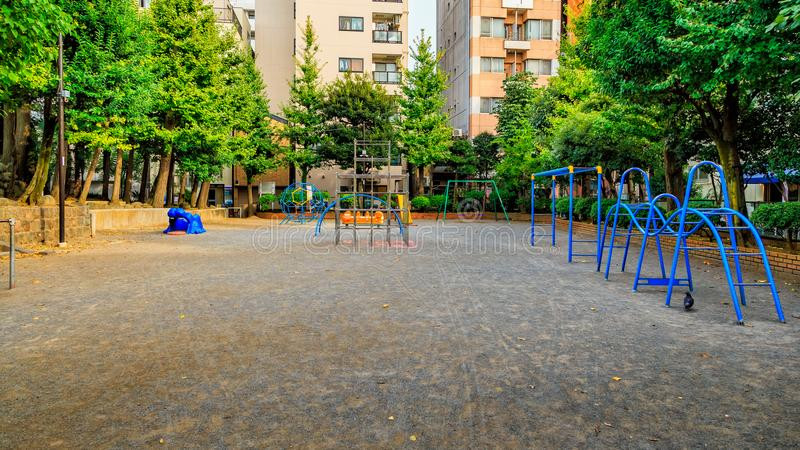 Empty playground with jungle gym and seesaw and slider, space for children stock photo
