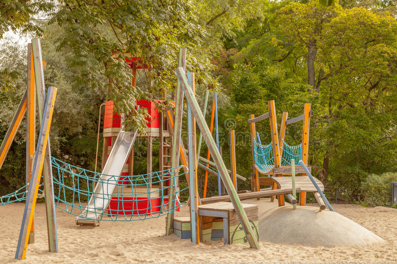 Playground for children in Berlin Germany. Empty playground for small children with wooden structures stock image