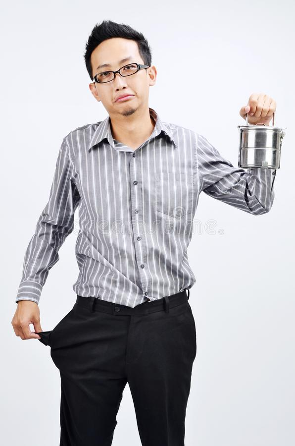 Empty pocket Asian businessman and lunch box royalty free stock image