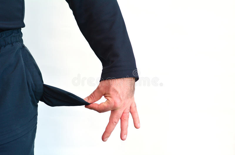 Empty pocket of a man without money stock photography