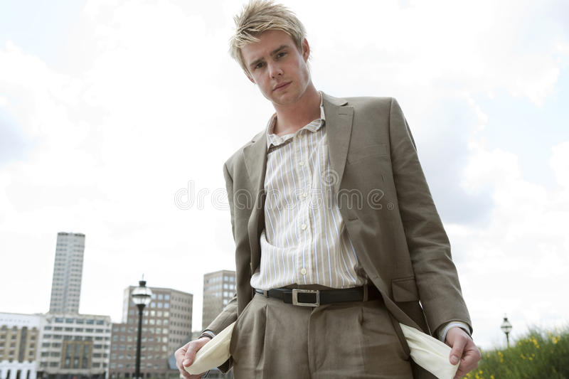 Empty pockets. Bust businessman pulling out his empty pockets stock images