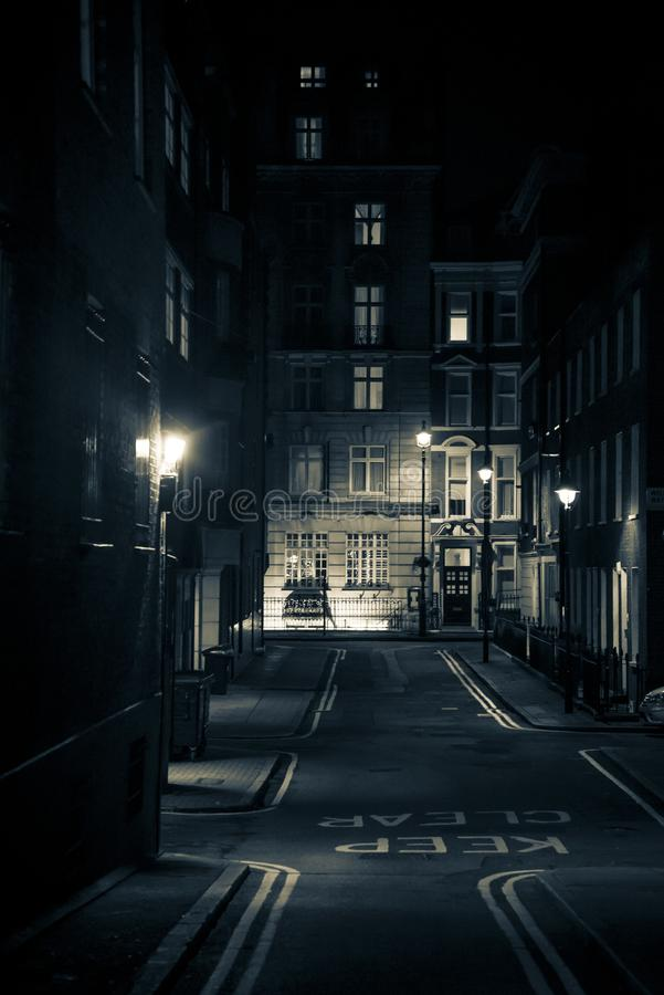 Empty posh street at night, City of Westminster, London, UK stock photography