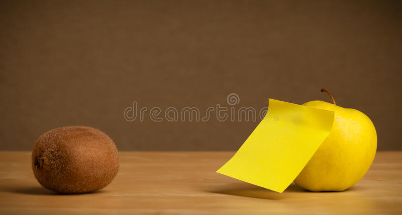 Empty post-it note sticked on fruit. Fruit with empty sticky note royalty free stock image