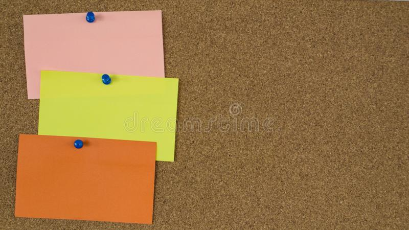 Empty post-it notes pinned in a scrum ban board. Empty colourful post-it notes pinned in a cork board. Project organisation methodology stock photography