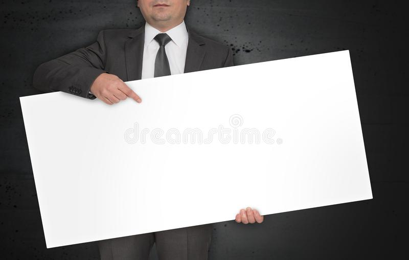 Empty poster is held by businessman royalty free stock photos