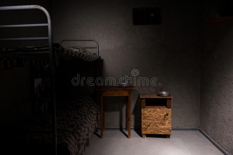 Download An Empty Prison Cell With Bunk Bed And Bedside Table Stock Photo    Image Of