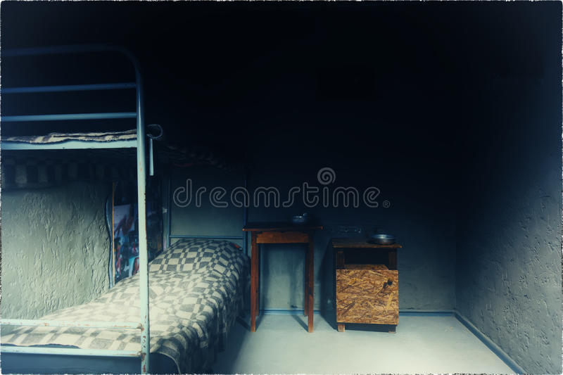 Download Empty Prison Cell With Iron Bunk Bed And Bedside Table Stock Photo    Image Of