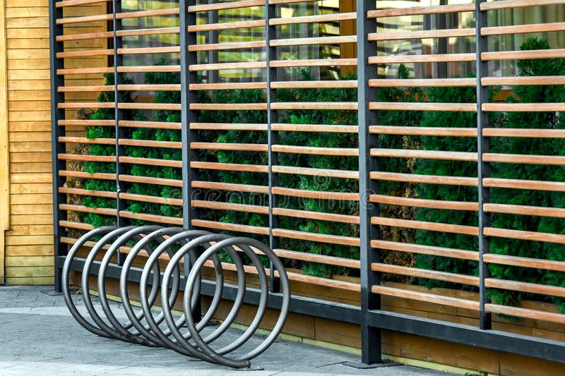 Empty public bicycle parking side view. Empty public bicycle parking side view, a place near the gazebo decorated with planks stock photos