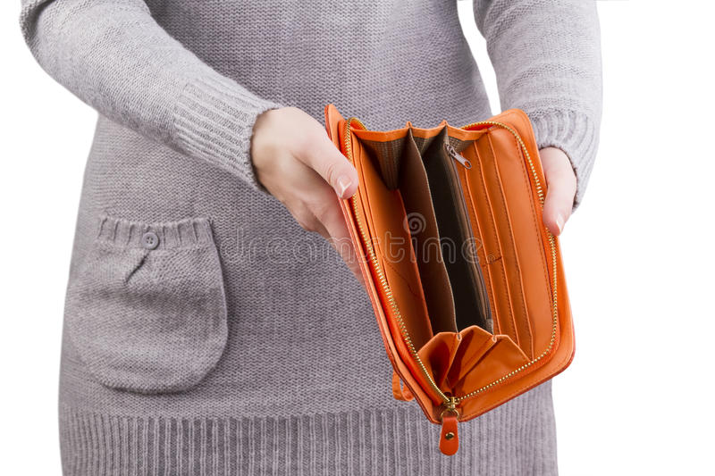 Empty purse in women`s hands. Background royalty free stock image