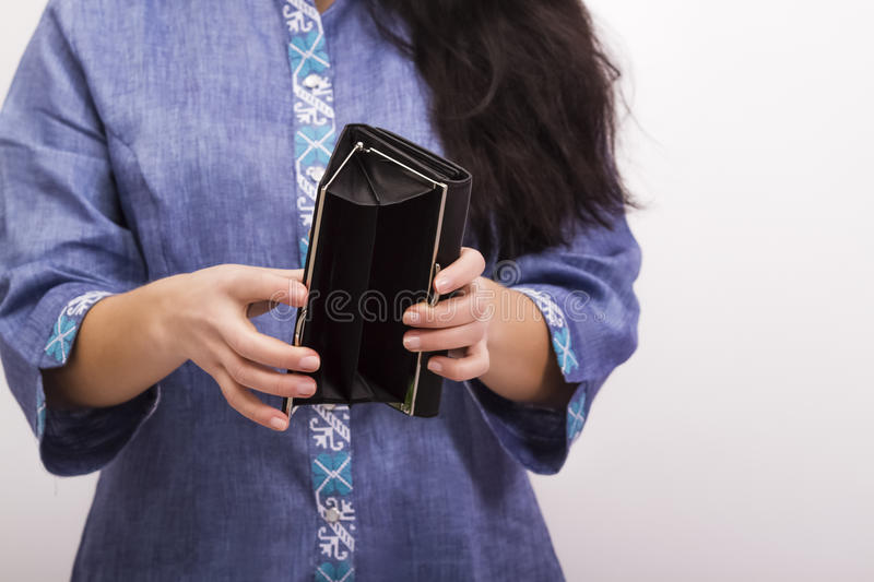 Empty purse in women`s hands; no money royalty free stock images