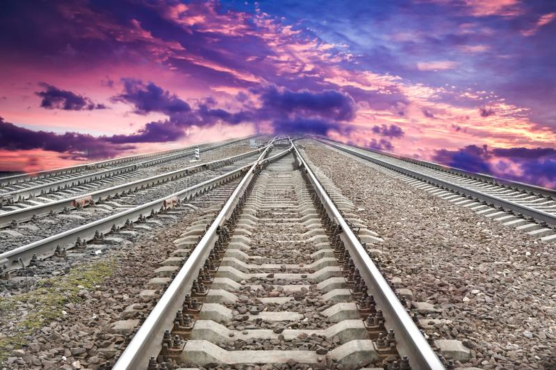 Empty railroad on a background of pink sky stock images