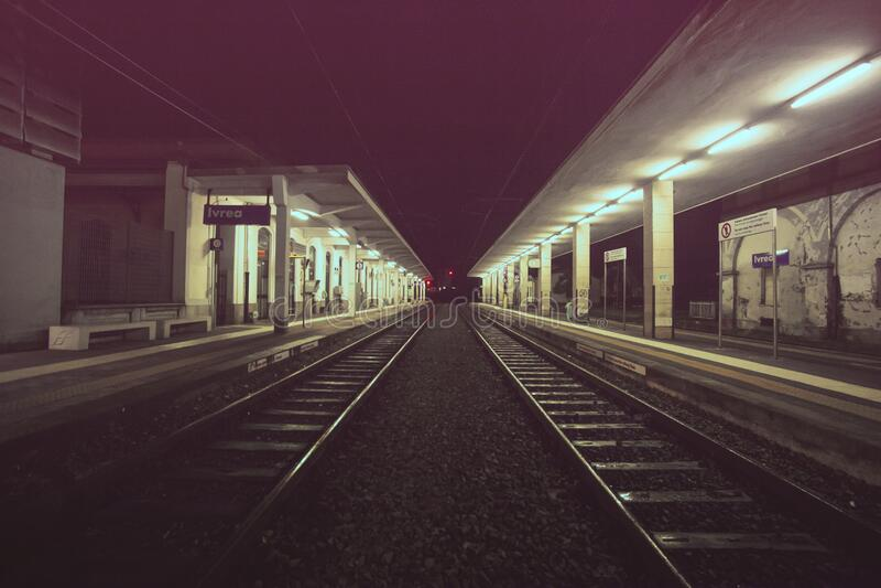 Empty railroad platform at night royalty free stock image