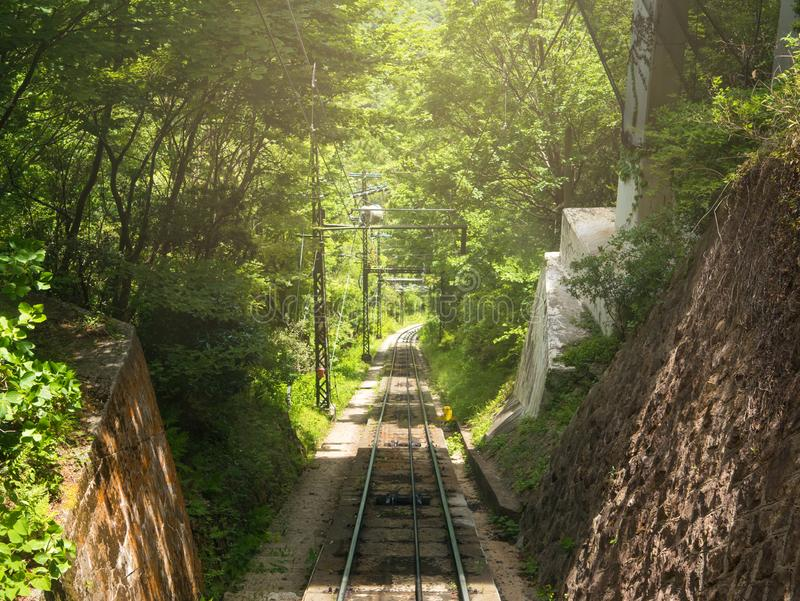 Empty railway of cable car for up to the top of the mountain.  stock photos