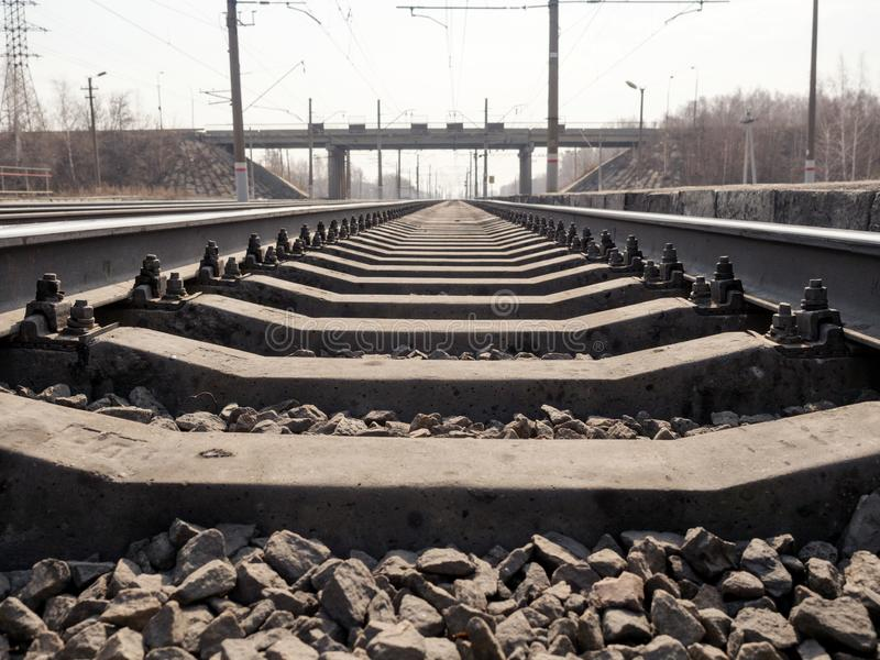 Empty railway line, rails, sleepers, rubble close up, wide angle, toned brown, selective focus. Empty railway line rails, sleepers, rubble close up, wide angle royalty free stock photos