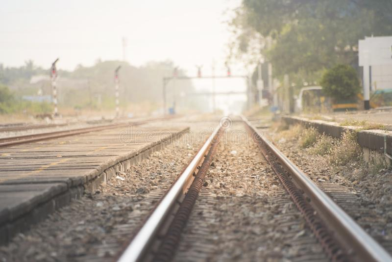 Empty railway with no train and people,selective focus and vintage style.  royalty free stock photo