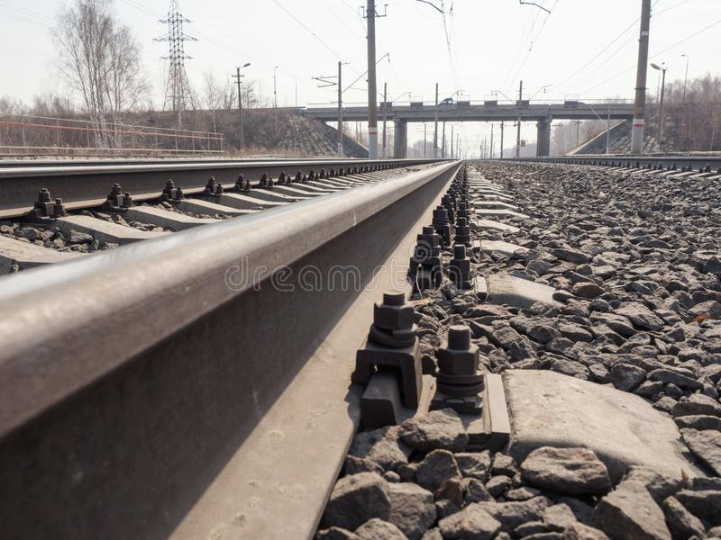 Empty railway, rails, sleepers, rubble close up, wide angle, toned brown, selective focus. Urban, industry, transportation freight and cargo traffic concept royalty free stock photography