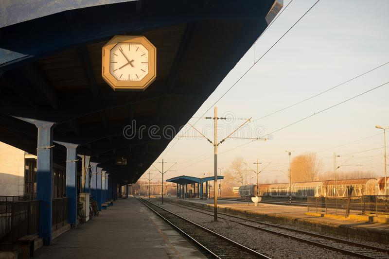 Empty railway station. Early morning on the empty railway station with clock without train vehicles and people in Novi Sad in Serbia stock photography