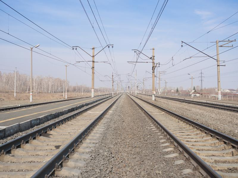 Empty railway station, lines and wires, wide angle, selective focus. Empty railway station, lines and wires wide angle, selective focus. Urban, industry stock images