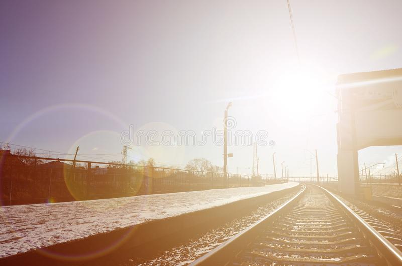 Empty railway station platform for waiting trains `Novoselovka` in Kharkiv, Ukraine. Railway platform in sunny winter da. Y royalty free stock images