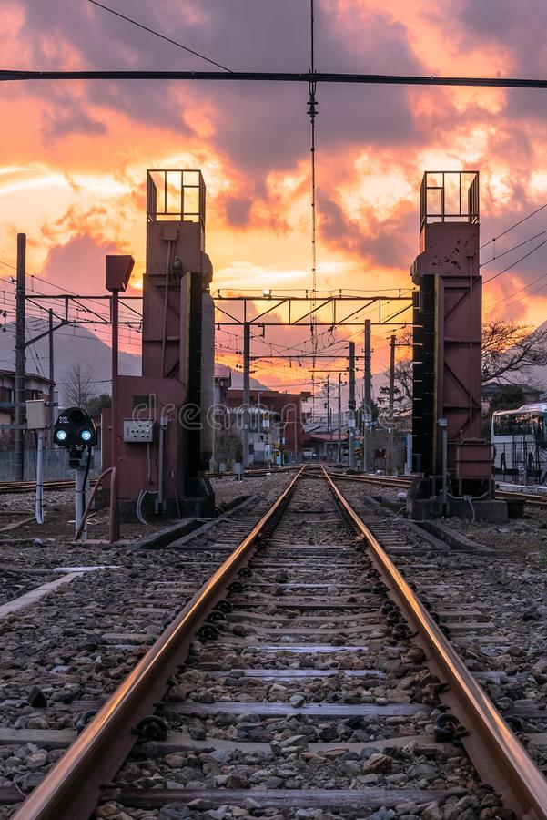 Empty railway track under colourful sky at sunset. Empty Railway Track with Switches in Background at Sunset. Fujikawaguchiko, Japan royalty free stock images