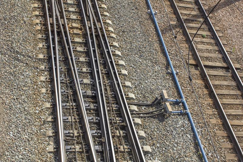 Empty railway tracks with mechanisms for changing direction of movement, top view royalty free stock images