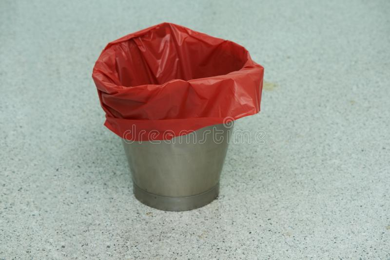 An empty red bin in operative room. An empty red garbage bin on the operating room floor royalty free stock images