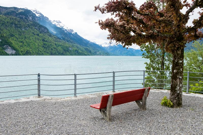 Empty red chair and landscape from Brienz town in Switzerland. royalty free stock image