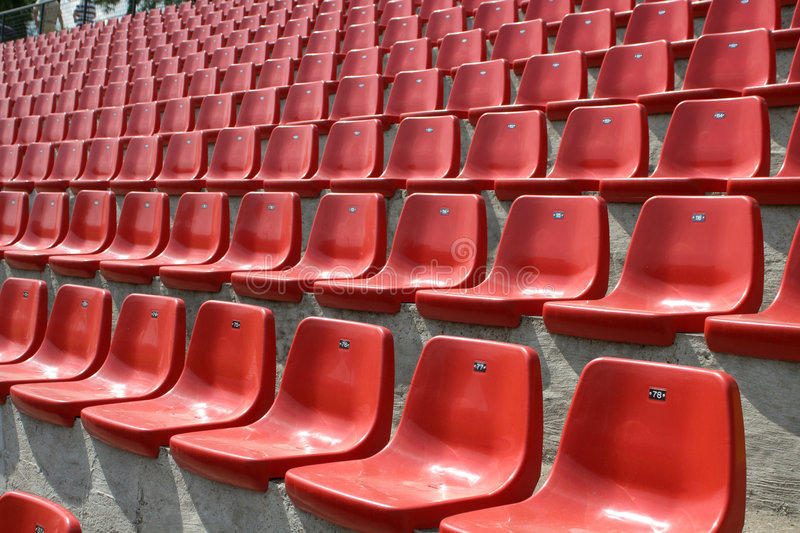 Empty red chairs. In open-air arena stock photos