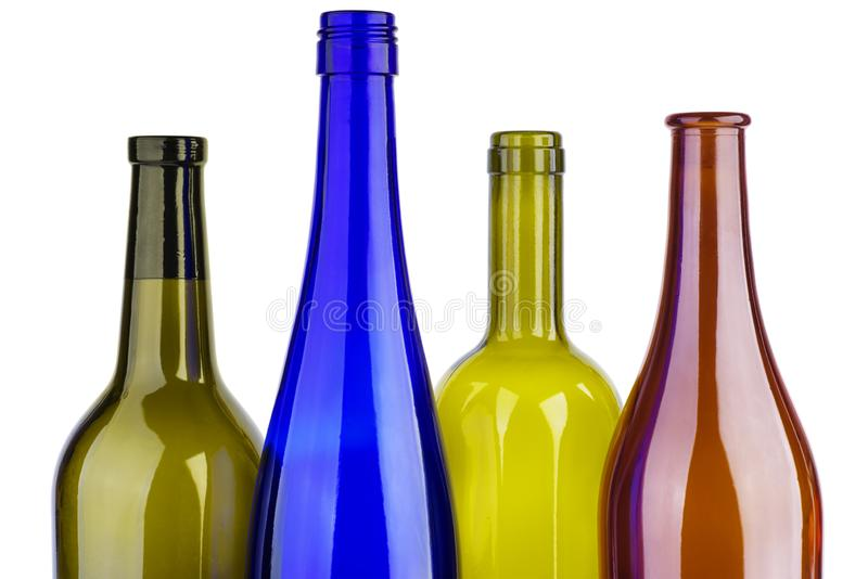 Empty red,green,yellow and blue wine bottles stock photos