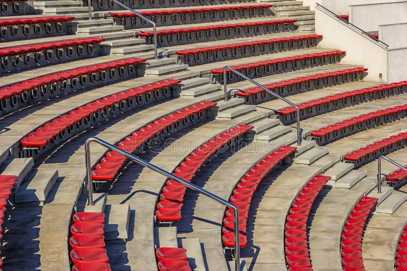Many empty seats for spectators in the stands royalty free stock photos