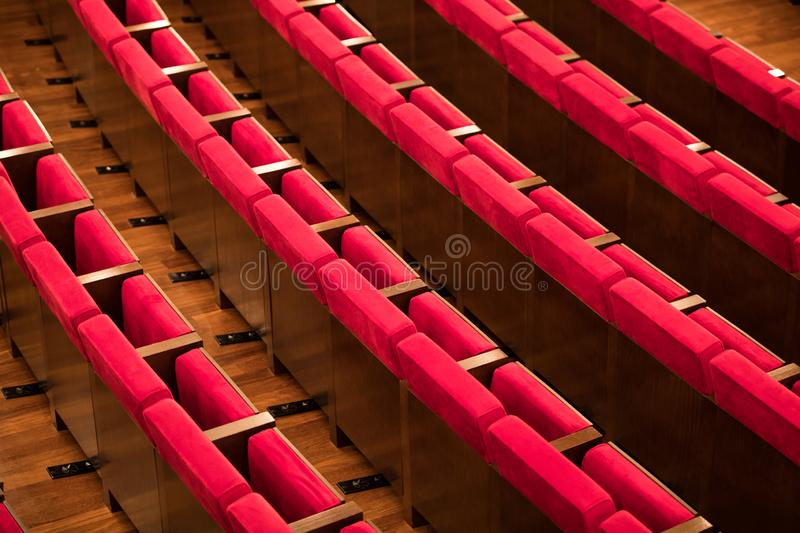 Empty red seats in a conference room royalty free stock images
