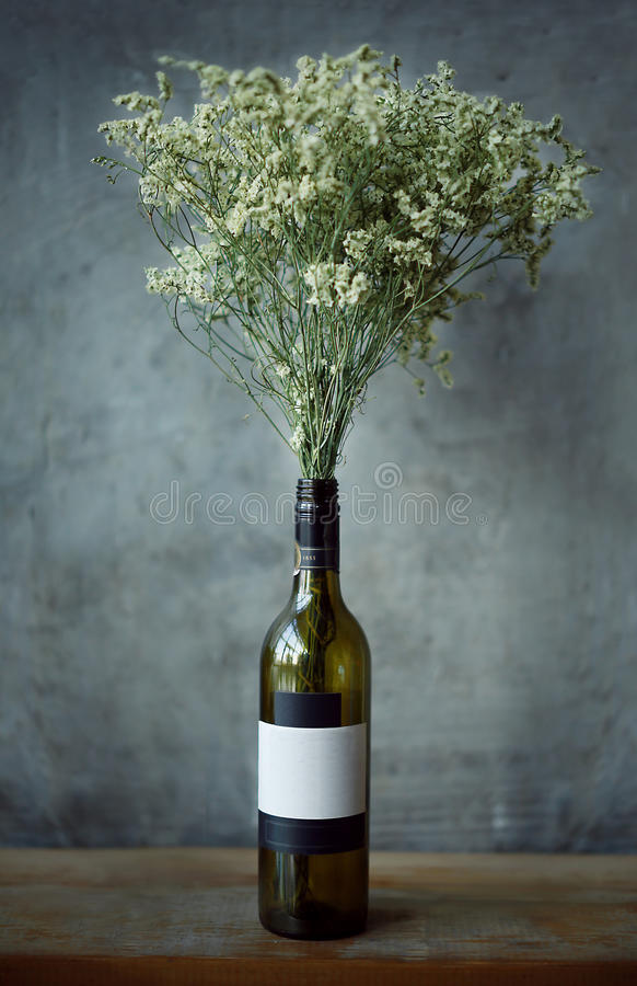 Empty red wine Glass bottles and flower royalty free stock photos