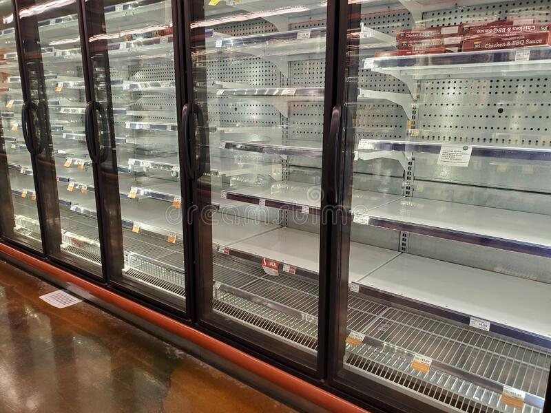Empty refridgerated shelves after hording of food from supermarkets stock image