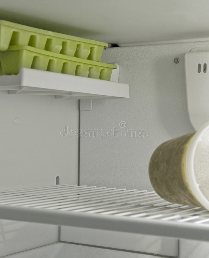 Empty refrigerator freezer. View into freezer with very little contents stock image