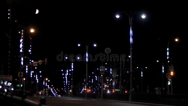 Empty residential street in the late evening with road signs and lanterns on black sky background. Stock footage. Night. Empty residential street in the late royalty free stock image