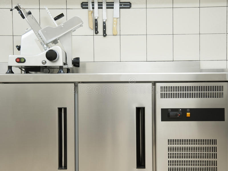 Empty restaurant kitchen with professional equipment a cutting m royalty free stock photo