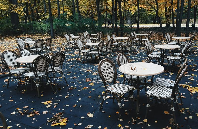 Empty restaurant tables and chairs. In autumn stock image
