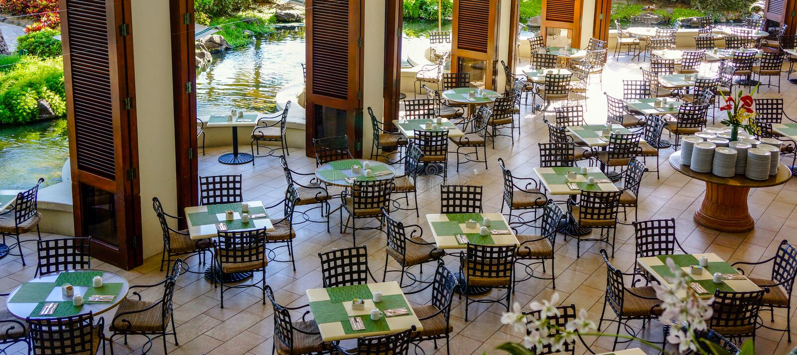 Empty Restaurant Tables and Chairs Awaiting Gueststy royalty free stock images