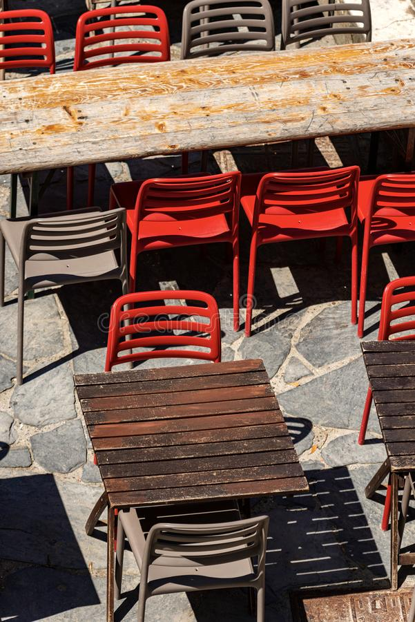 Empty restaurant tables and chairs - Liguria Italy. Close-up of empty restaurant tables and chairs in Liguria region, Italy, south Europe royalty free stock image