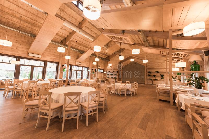 Empty restaurant with wooden interior. Empty modern restaurant with wooden interior royalty free stock image