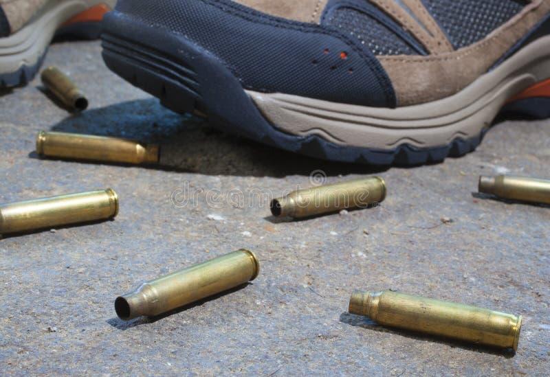 Empty rifle shells stock photography