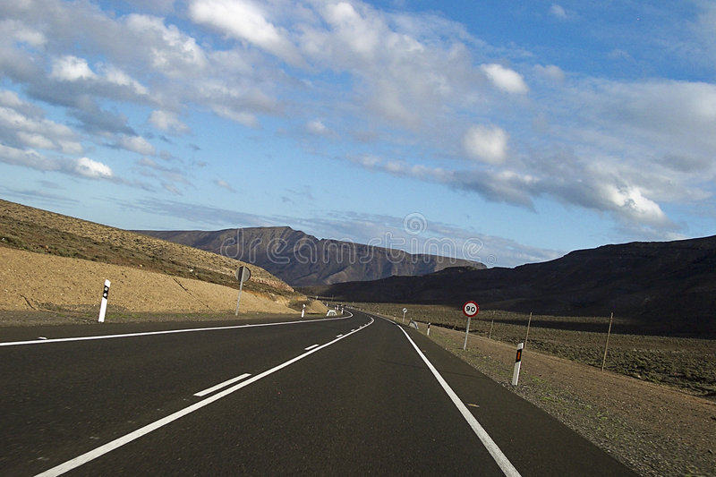 Empty road. An empty main road in Fuerteventura, Canary Islands. Slightly tilted view stock images