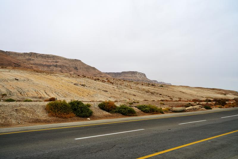 Empty road along the mountains in cloudy weather. Israel stock images