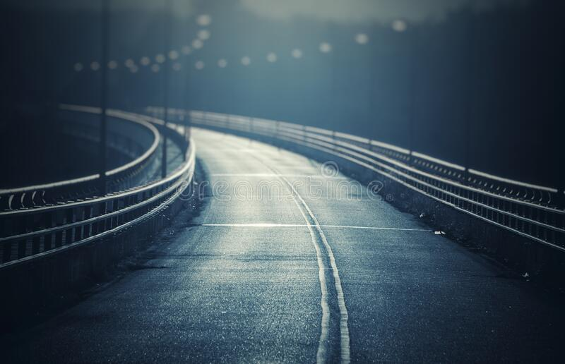 The Empty road / bridge to somewhere with double line and vintage look. The Empty road / bridge to somewhere with double line and vintage royalty free stock images