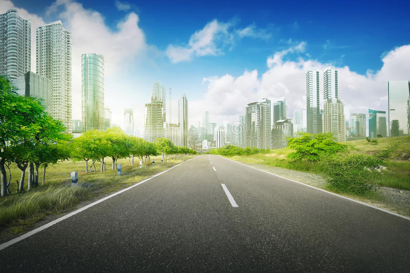 Empty road in the city. On the daytime, blue sky and city background stock photos