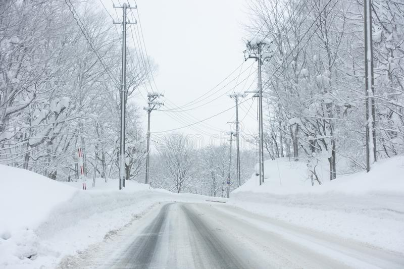 Empty road in countryside during snow royalty free stock images
